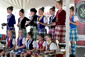 Girls in kilts receive medals