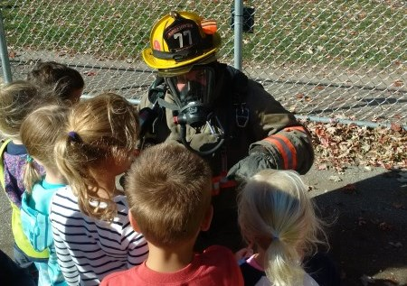 fire fighter with children